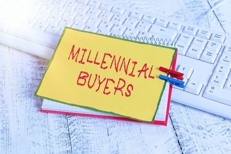 Writing note showing Millennial Buyers. Business concept for Type of consumers that are interested in trending products notebook reminder clothespin with pinned sheet light wooden