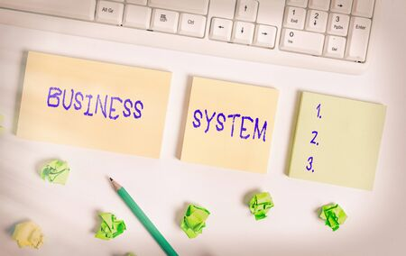 Writing note showing Business System. Business concept for A method of analyzing the information of organizations Flat lay above blank copy space sticky notes with business concept