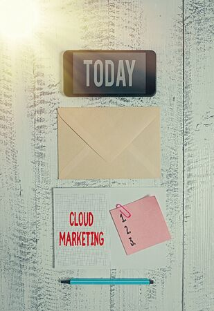 Word writing text Cloud Marketing. Business photo showcasing The process of an organisation to market their services Envelop smartphone notepad note clip marker old wooden vintage background