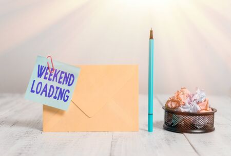 Writing note showing Weekend Loading. Business concept for Starting Friday party relax happy time resting Vacations Envelope sticky note marker paper balls container wooden background