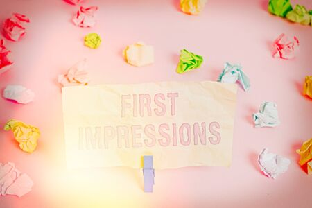 Writing note showing First Impressions. Business concept for What an individual thinks of you when they first meet you Colored crumpled papers empty reminder pink floor background clothespin Stock fotó