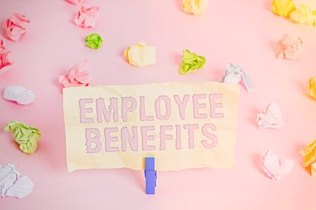 Writing note showing Employee Benefits. Business concept for Indirect and noncash compensation paid to an employee Colored crumpled papers empty reminder pink floor background clothespin Zdjęcie Seryjne