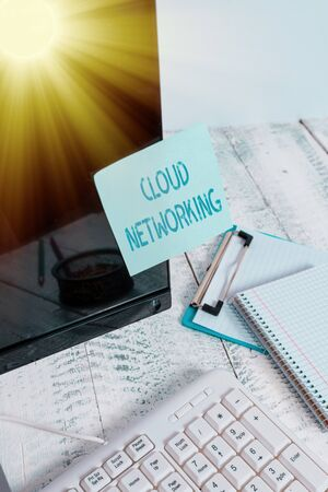 Word writing text Cloud Networking. Business photo showcasing is term describing access of networking resources Note paper taped to black computer screen near keyboard and stationary