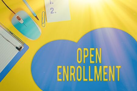Word writing text Open Enrollment. Business photo showcasing The yearly period when showing can enroll an insurance Metal clipboard blank paper sheet clip mouse pencil note colored background Standard-Bild