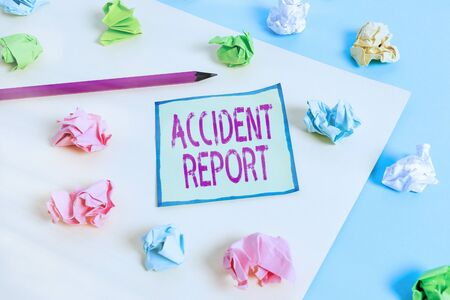Conceptual hand writing showing Accident Report. Concept meaning A form that is filled out record details of an unusual event Colored crumpled paper empty reminder blue yellow clothespin