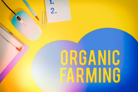 Word writing text Organic Farming. Business photo showcasing an integrated farming system that strives for sustainability Metal clipboard blank paper sheet clip mouse pencil note colored background