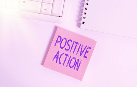 Word writing text Positive Action. Business photo showcasing doing good attitude against certain situation Fine reaction Empty note paper on the white background by the pc keyboard with copy space