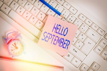 Handwriting text Hello September. Conceptual photo Eagerly wanting a warm welcome to the month of September Empty copy space red note paper bubble above pc keyboard for text message Banco de Imagens