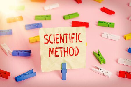 Conceptual hand writing showing Scientific Method. Concept meaning Principles Procedures for the logical hunt of knowledge Colored clothespin papers empty reminder pink floor office pin