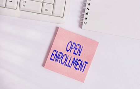 Word writing text Open Enrollment. Business photo showcasing The yearly period when showing can enroll an insurance Empty note paper on the white background by the pc keyboard with copy space