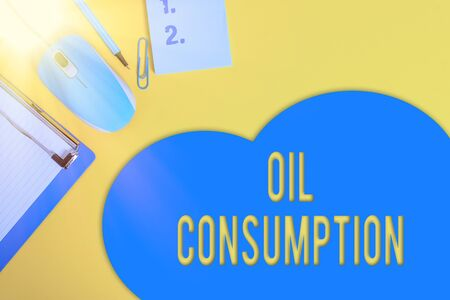 Word writing text Oil Consumption. Business photo showcasing This entry is the total oil consumed in barrels per day Metal clipboard blank paper sheet clip mouse pencil note colored background