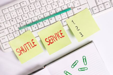 Handwriting text writing Shuttle Service. Conceptual photo vehicles like buses travel frequently between two places Three empty green square papers by the pc keyboard with copy space Reklamní fotografie