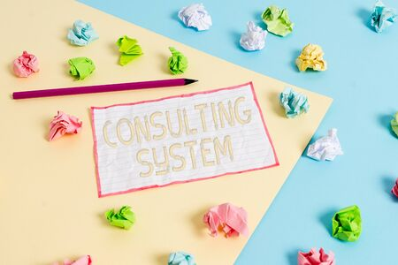 Conceptual hand writing showing Consulting System. Concept meaning Helping firms improve process adequacy and functionality Colored crumpled papers empty reminder blue yellow clothespin