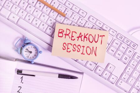 Text sign showing Breakout Session. Business photo text workshop discussion or presentation on specific topic Flat lay above empty note paper on the pc keyboard pencils and clock