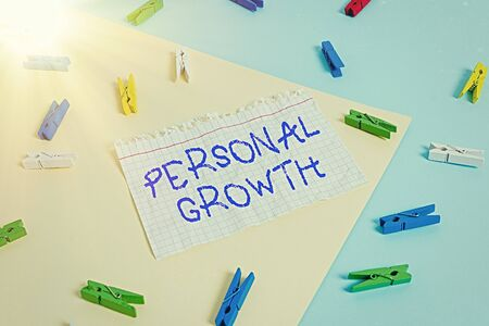 Word writing text Personal Growth. Business photo showcasing improve develop your skills qualities Learn new materials Colored clothespin paper empty reminder yellow blue floor background office 版權商用圖片