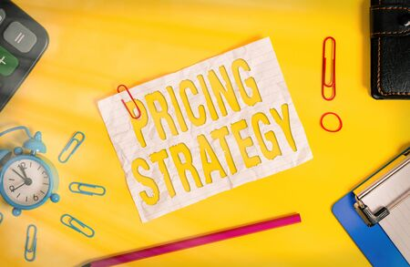 Conceptual hand writing showing Pricing Strategy. Concept meaning set maximize profitability for unit sold or market overall Alarm clock clipboard calculator wallet band pencil crushed sheet