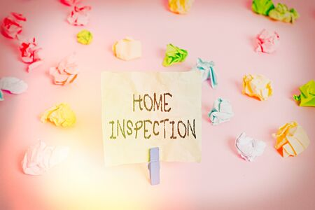 Conceptual hand writing showing Home Inspection. Concept meaning Examination of the condition of a home related property Colored crumpled papers empty reminder pink floor clothespin