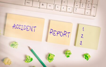 Writing note showing Accident Report. Business concept for A form that is filled out record details of an unusual event Flat lay above blank copy space sticky notes with business concept