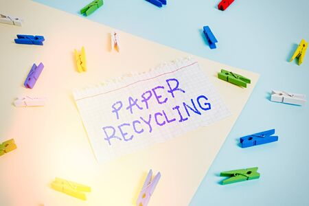Word writing text Paper Recycling. Business photo showcasing Using the waste papers in a new way by recycling them Colored clothespin paper empty reminder yellow blue floor background office Standard-Bild