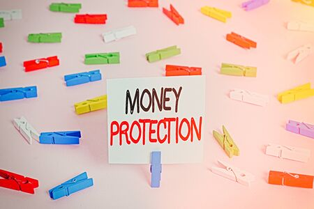 Word writing text Money Protection. Business photo showcasing protects the rental money tenant pays to landlord Colored clothespin papers empty reminder pink floor background office pin