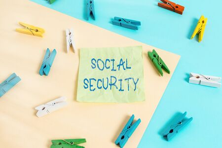 Writing note showing Social Security. Business concept for assistance from state showing with inadequate or no income Colored clothespin paper reminder with yellow blue background