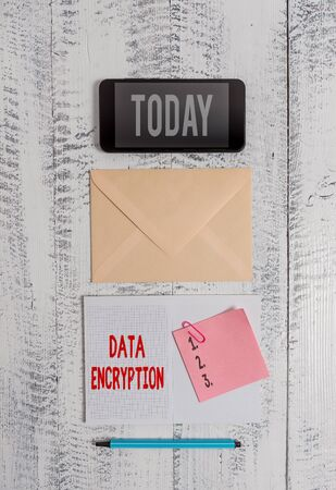 Word writing text Data Encryption. Business photo showcasing Symmetrickey algorithm for the encrypting electronic data Envelop smartphone notepad note clip marker old wooden vintage background