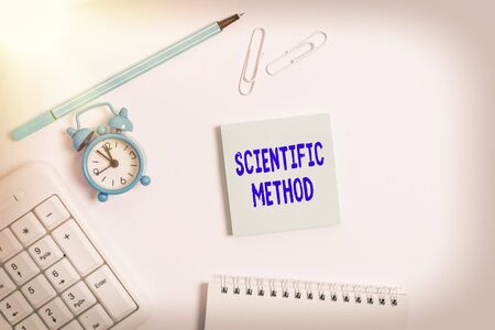 Conceptual hand writing showing Scientific Method. Concept meaning Principles Procedures for the logical hunt of knowledge Copy space on empty note paper with clock and pencil on the table