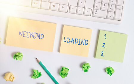 Writing note showing Weekend Loading. Business concept for Starting Friday party relax happy time resting Vacations Flat lay above blank copy space sticky notes with business concept