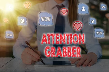 Writing note showing Attention Grabber. Business concept for Demanding notice mainly by being prominent or outlandish Stock Photo