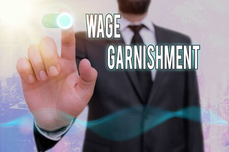 Conceptual hand writing showing Wage Garnishment. Concept meaning Deducting money from compensation ordered by the court Stock Photo