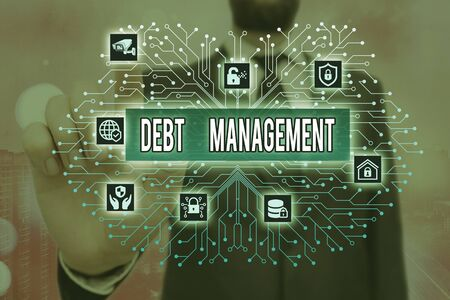 Writing note showing Debt Management. Business concept for The formal agreement between a debtor and a creditor Archivio Fotografico