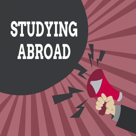 Conceptual hand writing showing Studying Abroad. Concept meaning learn outside of home in foreign country Travelling Male Hu analysis Hand Holding Megaphone Blank Speech Bubble