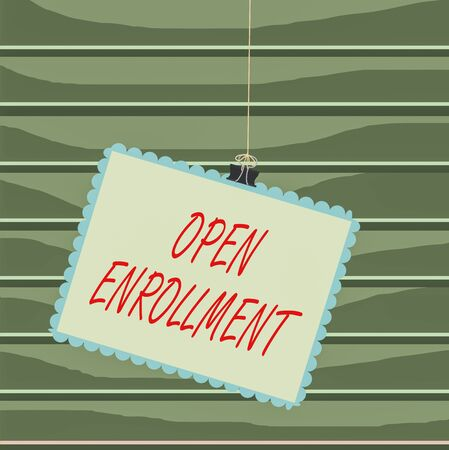 Conceptual hand writing showing Open Enrollment. Concept meaning The yearly period when showing can enroll an insurance Stamp stuck binder clip square color frame rounded tip
