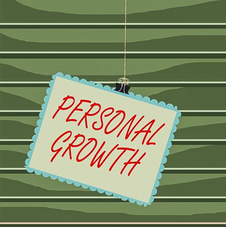Conceptual hand writing showing Personal Growth. Concept meaning improve develop your skills qualities Learn new materials Stamp stuck binder clip square color frame rounded tip