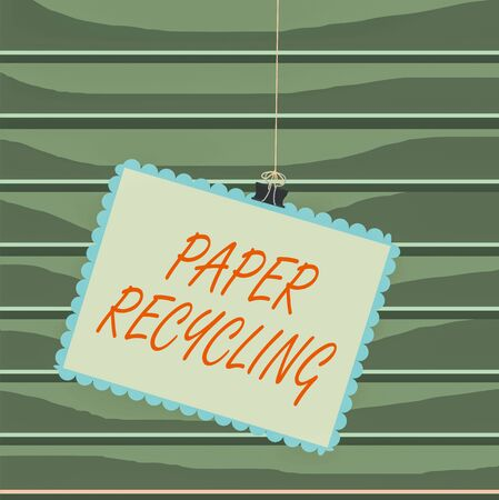 Conceptual hand writing showing Paper Recycling. Concept meaning Using the waste papers in a new way by recycling them Stamp stuck binder clip square color frame rounded tip