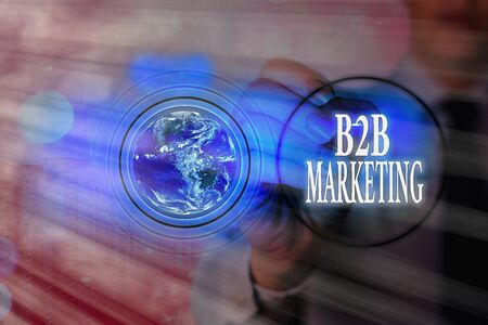 Writing note showing B2B Marketing. Business concept for Partnership Companies Supply Chain Merger Leads Resell Elements of this image furnished by NASA