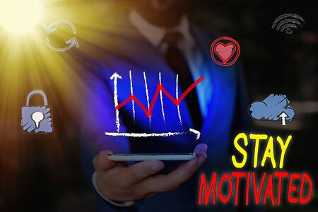 Text sign showing Stay Motivated. Business photo showcasing Reward yourself every time you reach a goal with knowledge