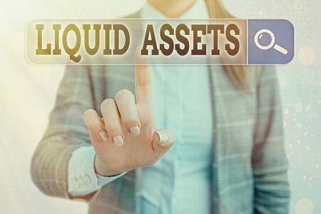 Handwriting text writing Liquid Assets. Conceptual photo Cash and Bank Balances Market Liquidity Deferred Stock Фото со стока