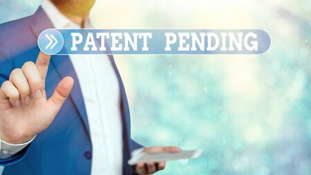 Text sign showing Patent Pending. Business photo showcasing Request already filed but not yet granted Pursuing protection