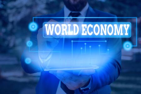 Writing note showing World Economy. Business concept for Global Worldwide International markets trade money exchange