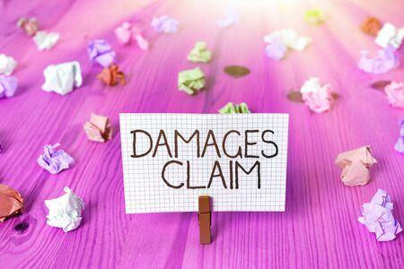Text sign showing Damages Claim. Business photo showcasing Demand Compensation Litigate Insurance File Suit