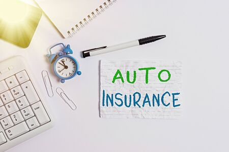 Handwriting text writing Auto Insurance. Conceptual photo Protection against financial loss in case of accident Flat lay above computer mobile phone clock pencil and copy space note paper