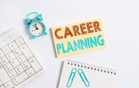 Writing note showing Career Planning. Business concept for Strategically plan your career goals and work success Keyboard with empty note paper and pencil white background