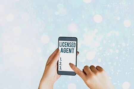 Writing note showing Licensed Agent. Business concept for Authorized and Accredited seller of insurance policies