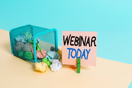Writing note showing Webinar Today. Business concept for live online educational presentation on different location Trash bin crumpled paper clothespin reminder office supplies