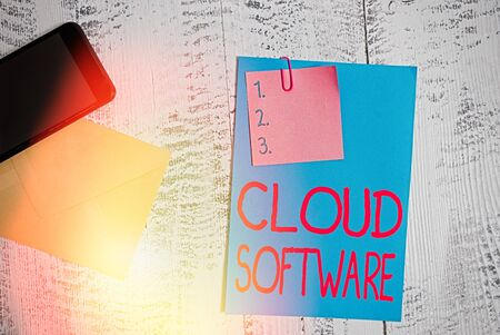 Text sign showing Cloud Software. Business photo showcasing Programs used in Storing Accessing data over the internet Envelope blank sheet paper sticky note smartphone wooden vintage background