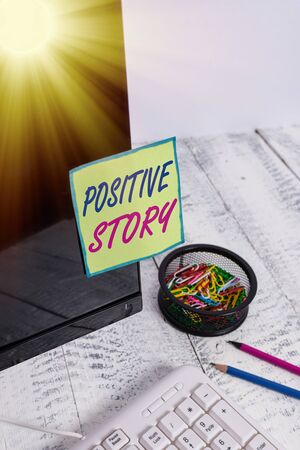 Conceptual hand writing showing Positive Story. Concept meaning Meaningful and motivating article Good News Success scoop Note paper taped to black screen near keyboard stationary