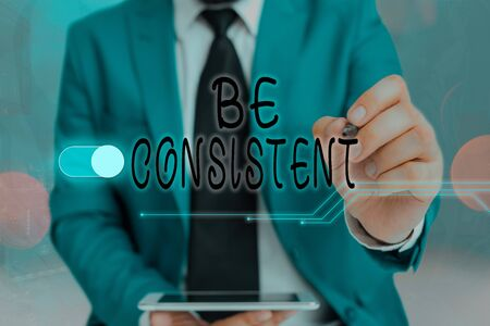 Writing note showing Be Consistent. Business concept for Uniform Persistent Firm Unalterable Even Unchanging Rapport