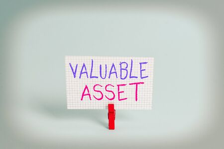 Conceptual hand writing showing Valuable Asset. Concept meaning Your most valuable asset is your ability or capacity Colored clothespin rectangle shaped paper blue background