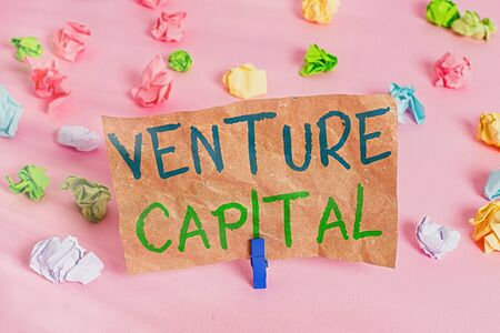 Conceptual hand writing showing Venture Capital. Concept meaning financing provided by firms to small early stage ones Colored crumpled papers empty reminder pink floor clothespin Фото со стока